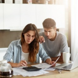 young couple going over finances | Century 21 Action, Inc Real Estate