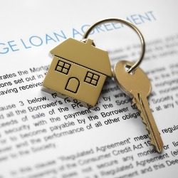 loan agreement with keys to a house | Century 21 Action, Inc Real Estate