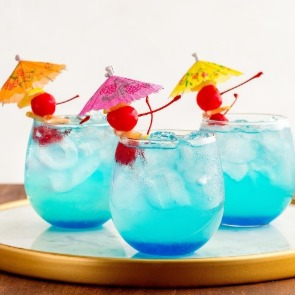 Blue mermaid lemonade in glasses with umbrellas | Century 21 Action Topsail Realty