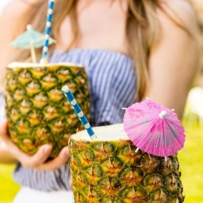Pina Coladas in Pineapple Cups with Umbrellas | Century 21 Action Topsail Realty