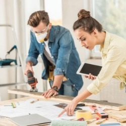 couple working on home improvements | Century 21 Action