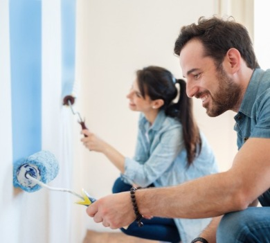 couple painting their vacation homes walls | Century 21 Action