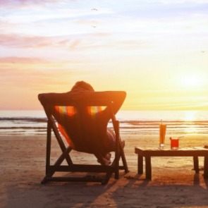 person watching sunset on the beach | Century 21 Topsail