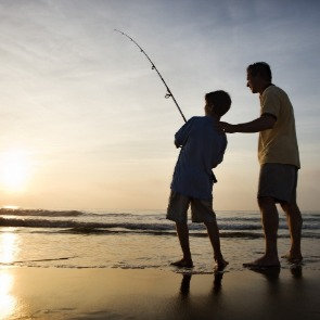 father and son fishing on the beach | Century 21 Topsail